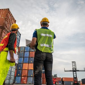 port employee checks containers in the container terminal